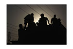 India (Men on lorry at sunset)