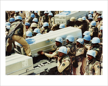 Pakistani troops and coffins of their comrades